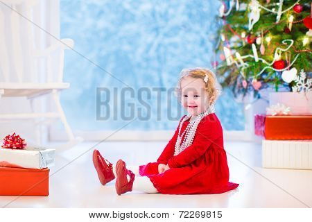 Little Girl Under Christmas Tree