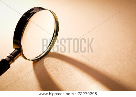 Close Up Magnifying Glass On Brown Platform