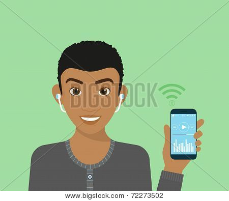Young guy is listening to music via bluetooth