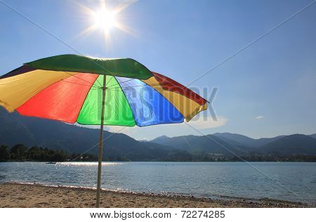 Lake-shore Of Tegernsee With Sunshade In Rainbow Colors