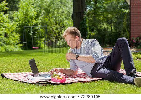 Businessman Relaxing In A Garden