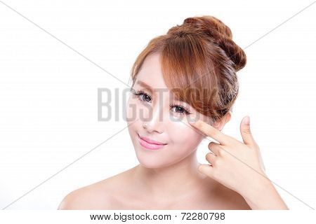 Young Woman Applying Moisturizer Cream On Face