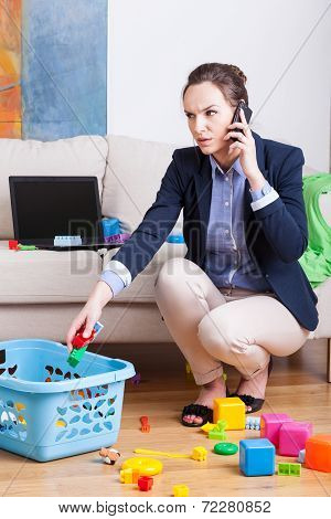 Woman Working And Organising Toys