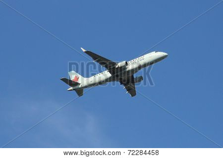 Air Canada Express Embraer ERJ plane taking off from La Guardia Airport