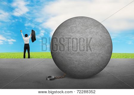 Businessman Cheering For Free From Concrete Ball Shackle