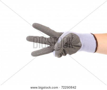 Hand in glove showing three.