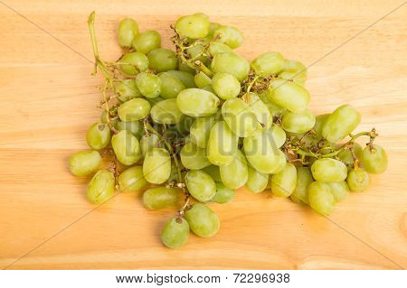 Bunch Of Green Seedless Grapes On Wood Table