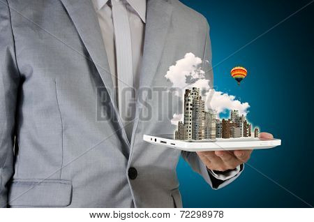 Man Holding Touch Screen Tablet And City