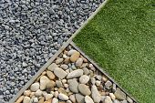 picture of stone house  - Landscaping combinations of grass pebble and stones - JPG