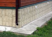 pic of downspouts  - Cottage foundation faced by artificial stone photo - JPG