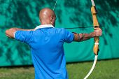 picture of archer  - archer at shooting range with bow and arrow - JPG