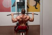 pic of light weight  - Male Bodybuilder Doing Heavy Weight Exercise For Back - JPG