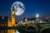 image of westminster bridge  - Twilight scene in London with Big Ben and the Houses of Parliament with a full moon and traffic on Westminster bridge  - JPG