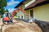 image of crusher  - A house is being forclosed and demolished with a crusher - JPG