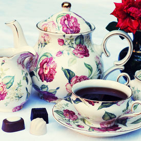 picture of english rose  - Traditional english tea with floral dishware and rose - JPG
