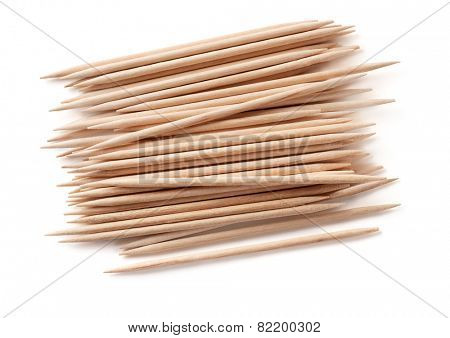 Pile of wooden toothpicks isolated on white