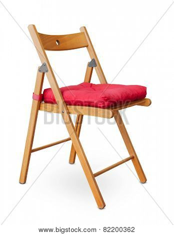 Wooden folding chair with pad isolated on white