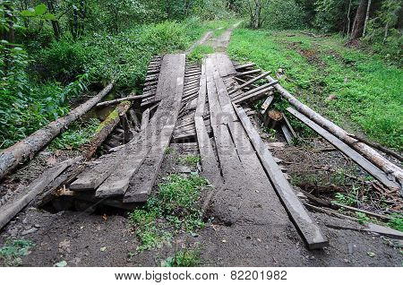 Dirty Broken Wooden Bridge In Forest