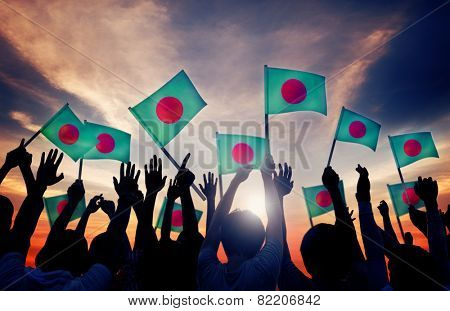 Silhouettes of People Holding Flag of Bangladesh