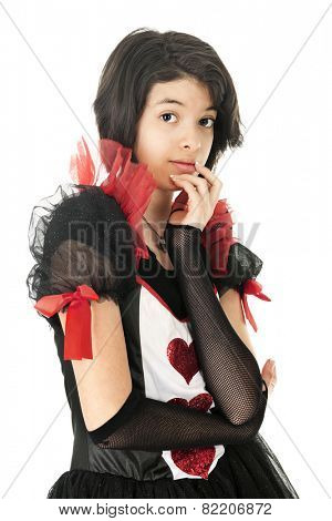 An attractive shy young teen looking at the viewer as she contemplates in her red, black and white valentine dress.  On a white background.
