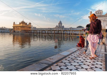 Young Sikh Men Visiting In Golden Temple In The Early Morning. Amritsar. India