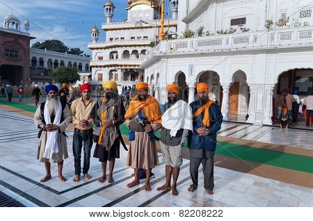 Group Of Indian Sikh Men In Golden Temple. Amritsar. India