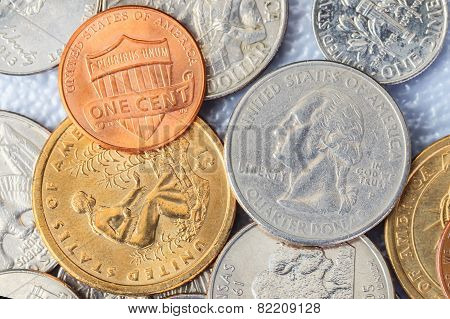 Group Of Us American Coins And One Cent On Top
