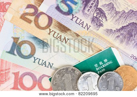 Chinese Or Yuan Banknotes Money And Coins From China's Currency With Boarding Pass Visa For Travel C