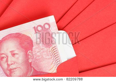 Chinese Or 100 Yuan Banknotes Money In Red Envelope, As Chinese New Year Background