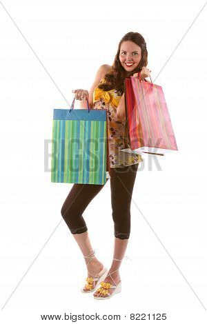 Pretty shopping girl with bags