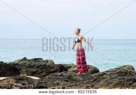 Woman in the top of swimwear and colorful pants
