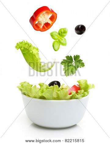 Vegetable salad in bowl isolated on white.