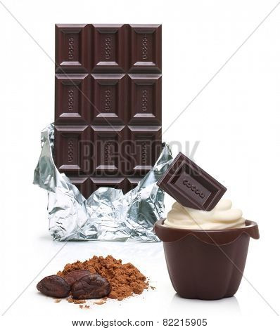 Dark chocolate bar in foil, cupcake, cacao beans and powder  isolated on white background