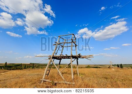 Wooden tower viewpoint in steppe under nice sky
