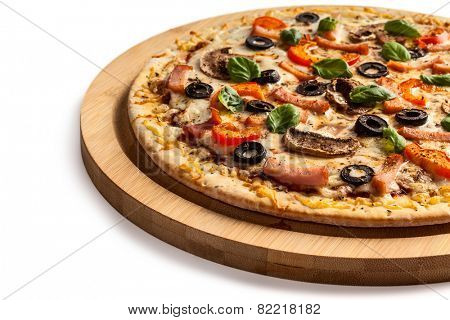 Ham pizza with capsicum, mushrooms, olives and basil leaves isolated on white
