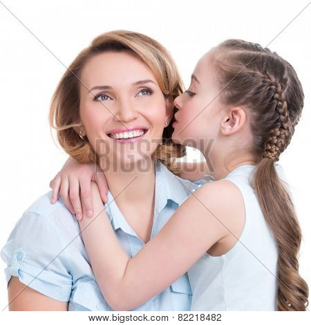 Portrait of a little girl telling her mother a secret studio shot on white background