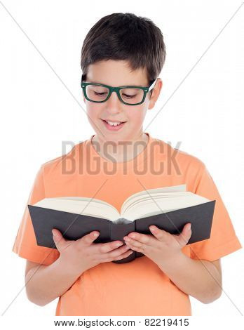 Smiling teenage boy of thirteen reading a book isolated on white