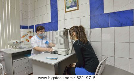 NOVOSIBIRSK, RUSSIA - DECEMBER 4, 2014: Patient in the ophthalmologist office of the Health Center. Health Centers are operated since 2010 and aimed to disease prevention