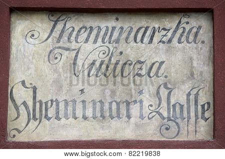 ZAGREB, CROATIA - APRIL 26, 2014: Ancient street name sign in the Upper Town of Zagreb, Croatia. Restorers have uncovered archaic bilingual street names long hidden under layers of plaster.