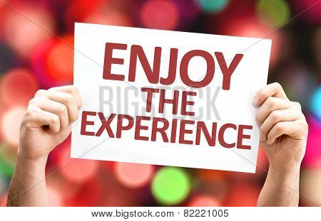 Enjoy the Experience card with colorful background with defocused lights