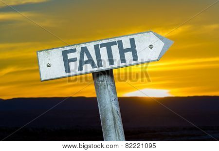 Faith sign with a sunset background