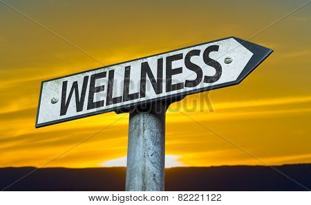 Wellness sign with a sunset background