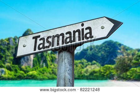 Tasmania sign with a beach on background