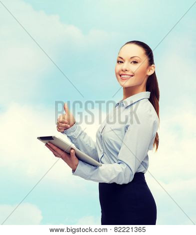 business, gesture, internet and technology concept - smiling woman looking at tablet pc computer showing thumbs up