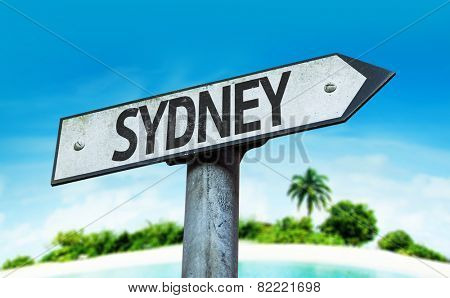 Sydney sign with a beach on background
