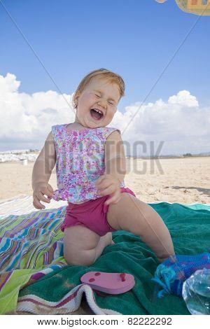 Happy Baby On Beach Towel