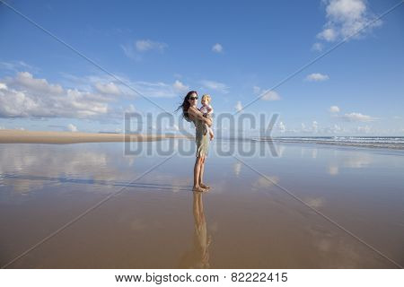 Mom With Baby At Lonely Beach