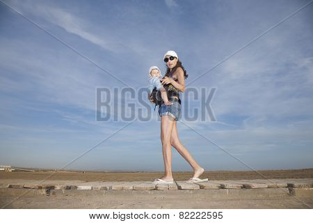 Shorts Mom With Baby In Rucksack