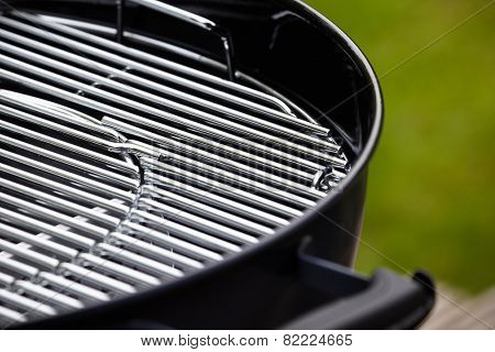 new barbecue grill in summer garden, outside, nobody