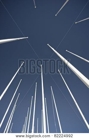 Masts no flag and clear blue sky.